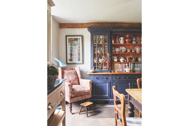 The dresser is the star of Antiques Roadshow expert Lisa Lloyd's kitchen – find more beautiful antique dressers at her shop, Hand of Glory Antiques & Interiors.