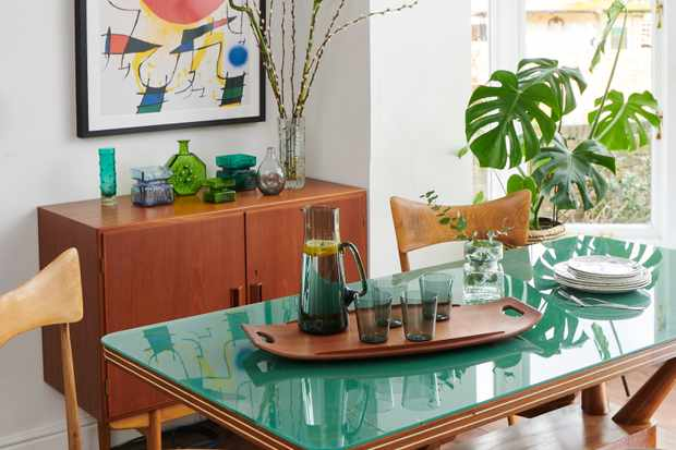 A mid-century dining room with teak furniture