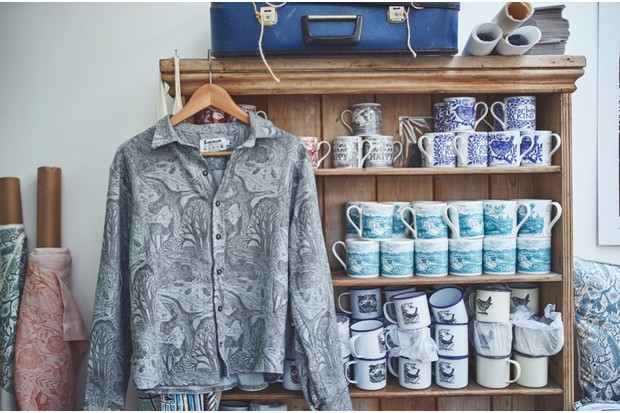 Several of Lou's designs printed on clothes, mugs and tea towels