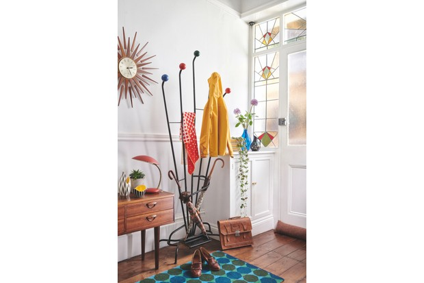 A space-age atomic coat stand alongside a colourful rug and vibrant ceramics