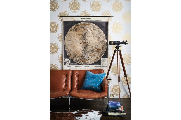 A retro vibe wallpaper with worn leather seating and an oversized chart