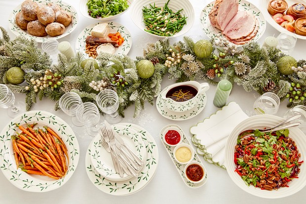 A Christmas dining table laden with food, by Sophie Conran