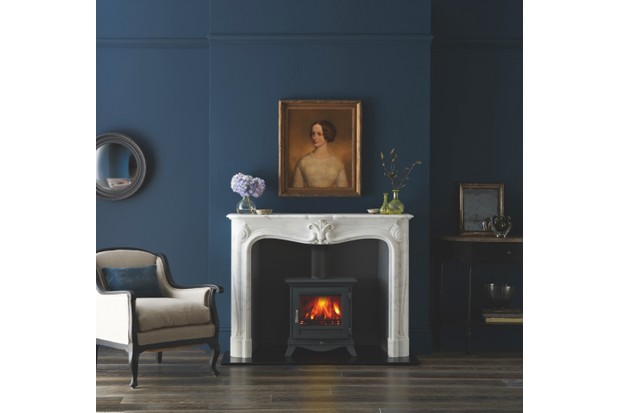Beaumont 5WS Series wood-burning stove in black, £1,400 (inc. VAT), and La Rochelle fireplace surround, £5,529 (inc. VAT), both Chesneys