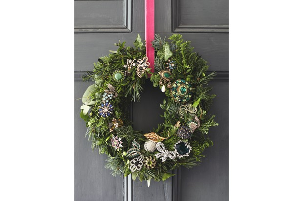 Handmade wreath, from £30, Winters Workshop. Vintage costume brooches from charity shops.