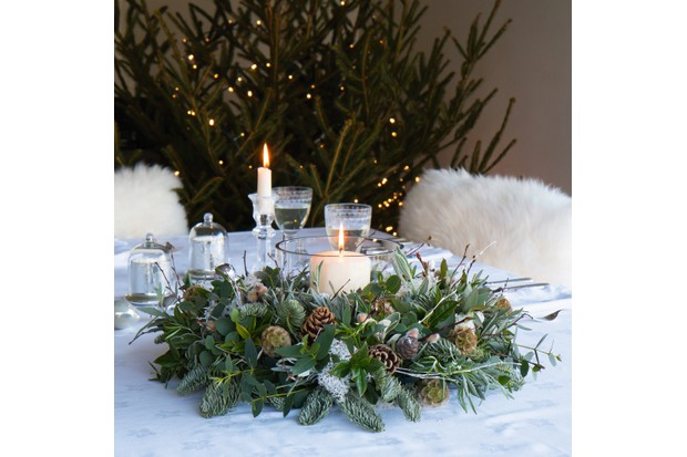 Nordic wreath featuring viburnum tinus and spherical scabius seedheads with silver lavender, rosemary, birch twigs and pine cones, £87, The Real Flower Company.