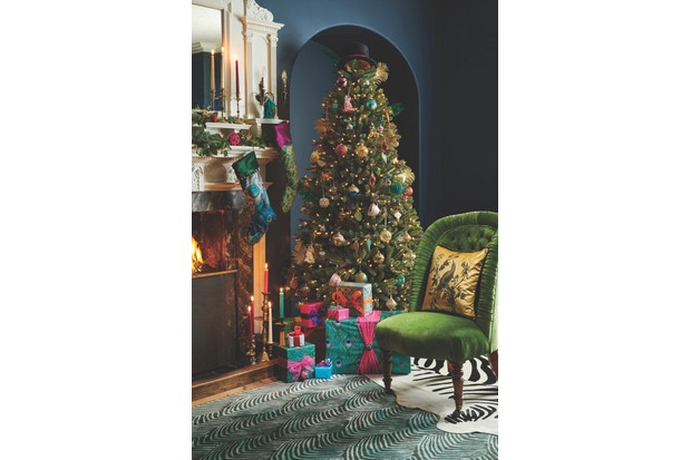 Christmas tree decorated with maximalist decorations
