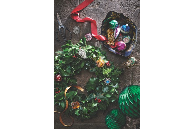 Wreath decorated with antique and vintage brooches