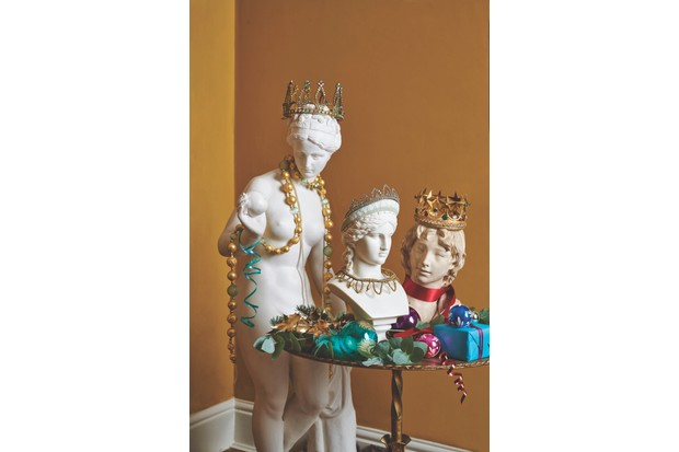 Antique busts decorated with tiaras, crowns and necklaces