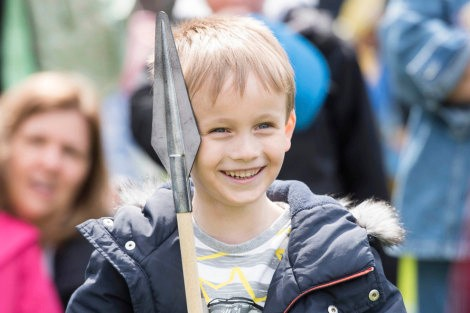 A young boy with a spear at the Tudors at the Tower family festival