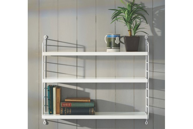 Pocket String Shelving System in white displayed with vintage books and a mochaware mug