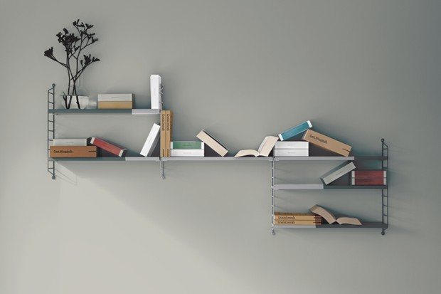 Pocket String Shelving System in grey displayed with books and plants