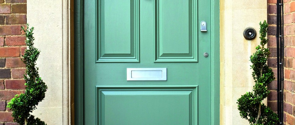 A traditional green front door