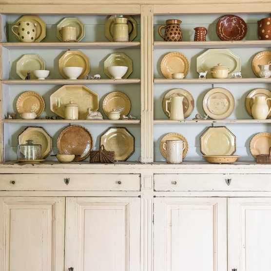 Collection of ceramics displayed on a kitchen dresser