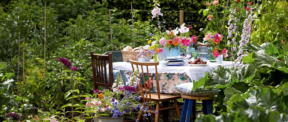 Summer garden party with floral decoration and antiques
