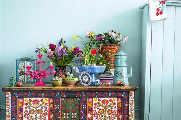 Folk art vases and vessels used to display fresh flowers