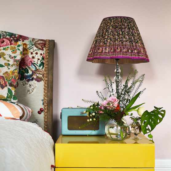 Upstairs, Maria used Calamine by Farrow & Ball as the backdrop for the main bedroom, where the bedside table is vintage Heal's and the lampshade is by Susan Deliss.