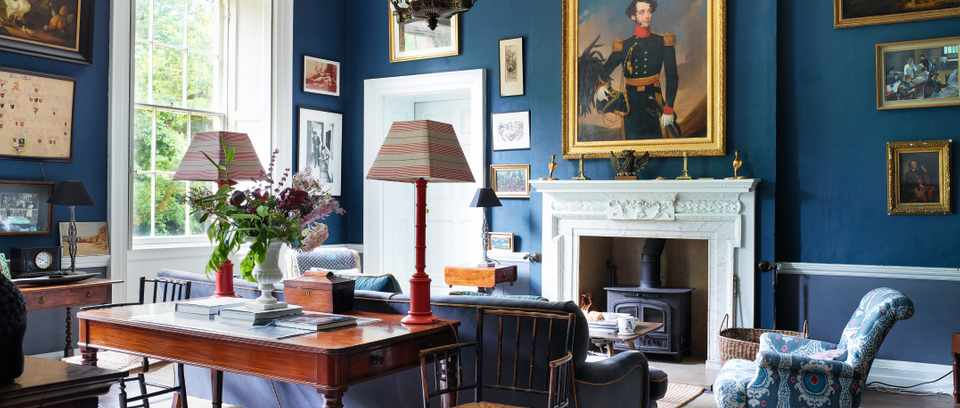 The navy blue living room at Deans Court