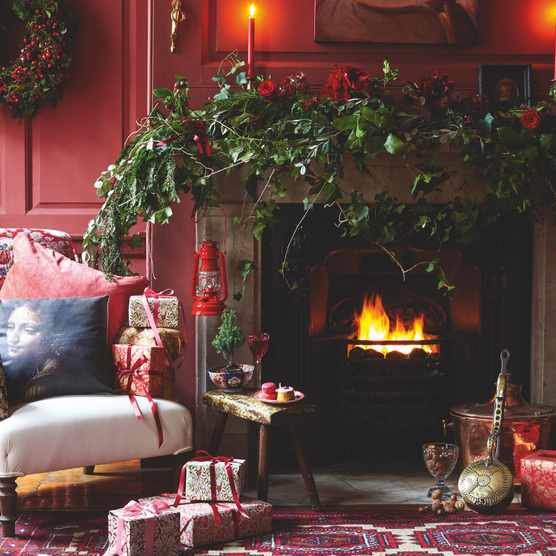 Marry rich tones of red with hints of gold and plenty of candlelight for an enveloping ambience that's warm and inviting. Finish with boughs of fresh foliage for a joyful look that's fit for the festive season