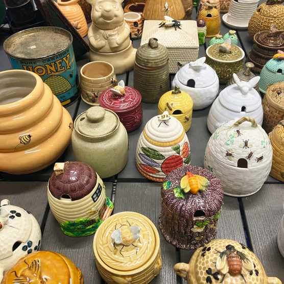 Honey pot collection belonging to James Hamill, Master Beekeeper and Founder of The Hive Honey Shop.