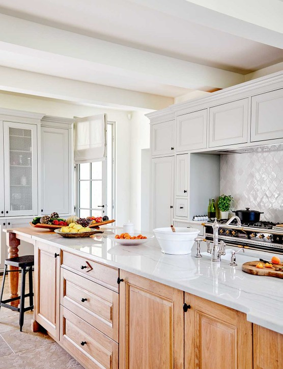 The kitchen is very much the heart of the house and the long island, made from French oak, was designed with this in mind – family and guests can gather to socialise as meals are prepared.