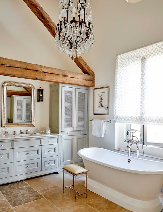 Michelle and Craig's en suite bathroom is a serene mix of practical and luxurious. The elegant cabinetry was designed by Michelle and made locally. The huge bath is from The Cast Iron Bath Company and the floor is made of natural stone from a local company.