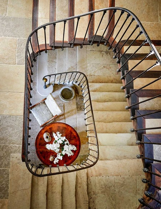 The dizzying view down the magnificent staircase from the top of the house to the entrance hall shows where the steps closest to the handrails have been worn over the centuries by successive owners of the property.