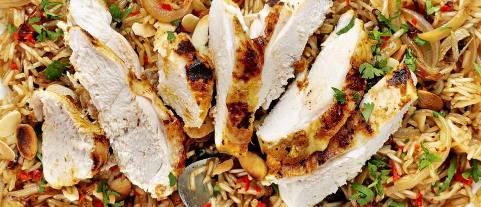 Yoghurt-spiced chicken with almond and coriander rice