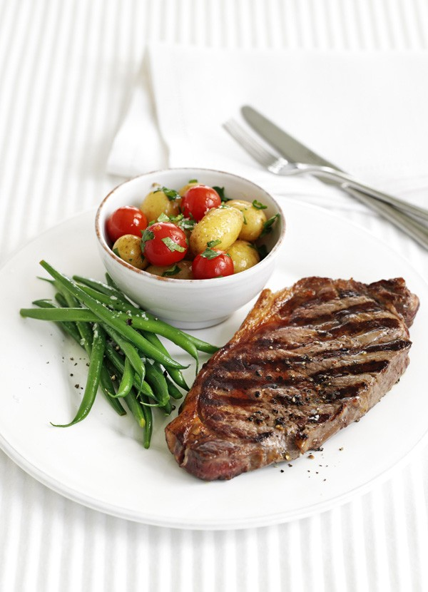 Lemon and pepper steak with warm potato salad