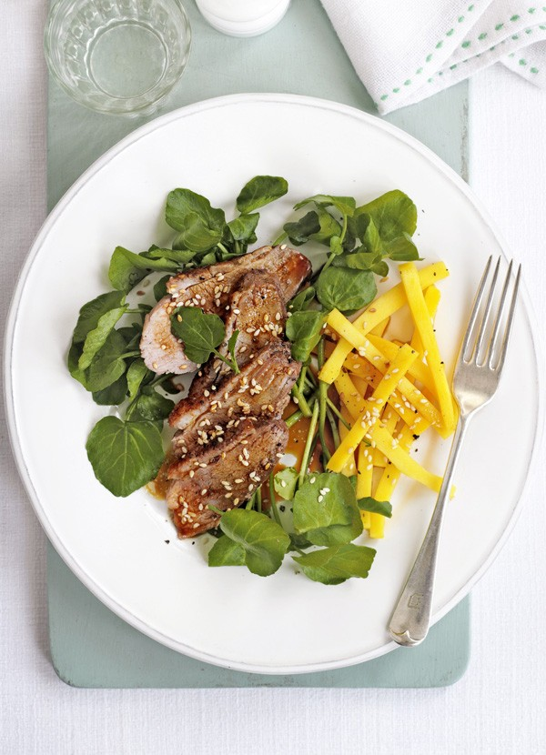 Duck and Mango Salad Recipe with Watercress served on a round white plate