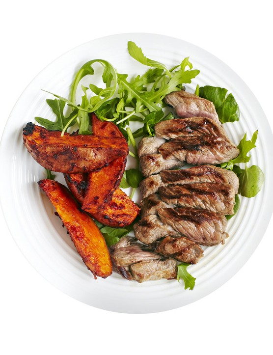 Lamb steaks with harissa-roasted sweet potatoes