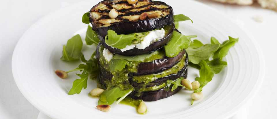 Aubergine stacks with pesto, pine nuts and goat's cheese