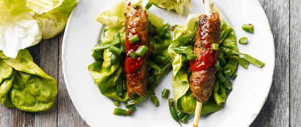 Lemongrass pork skewers with green bean salad