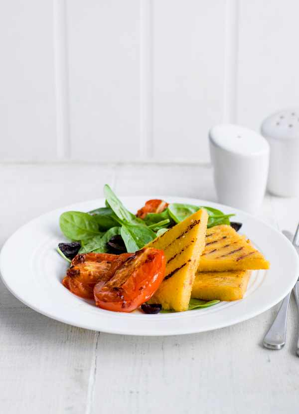 Grilled polenta with tomato and olive salad