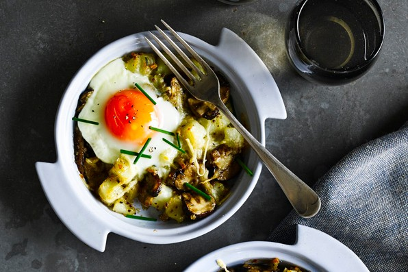Baked mushroom, potato and cheese hash with eggs