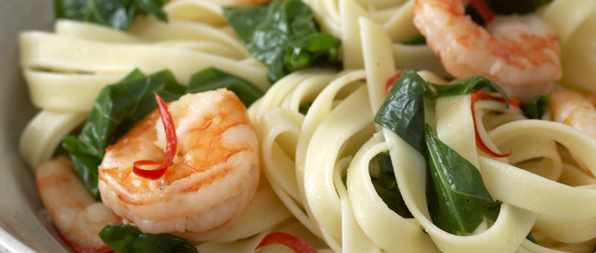 Linguine with prawns, spring greens and chilli