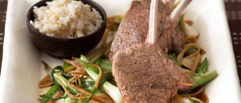 Lamb cutlets with stir-fried spring onions