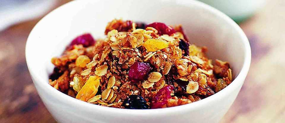 bowl of home made granola with fruits
