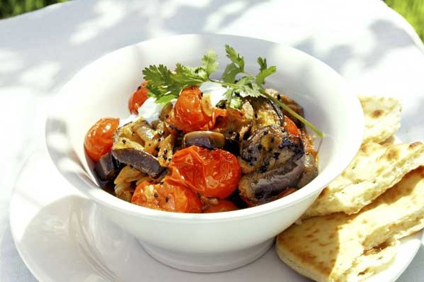 Aubergine curry with fresh tomato and coriander