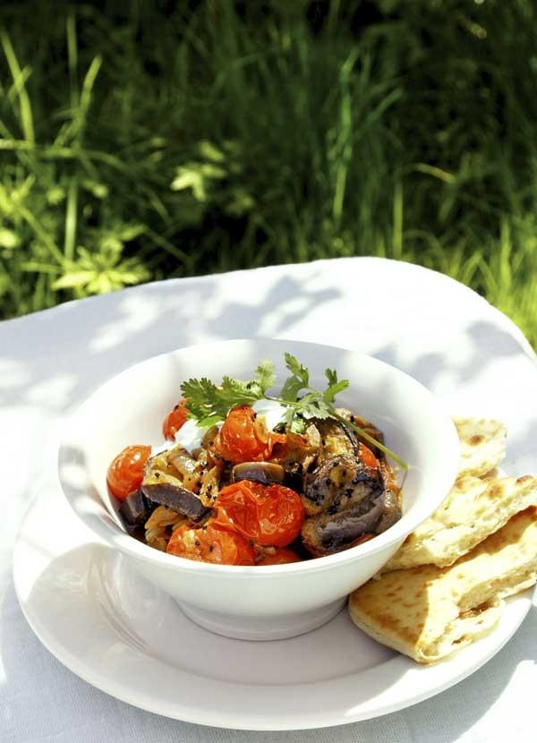 Aubergine curry with fresh tomato and coriander