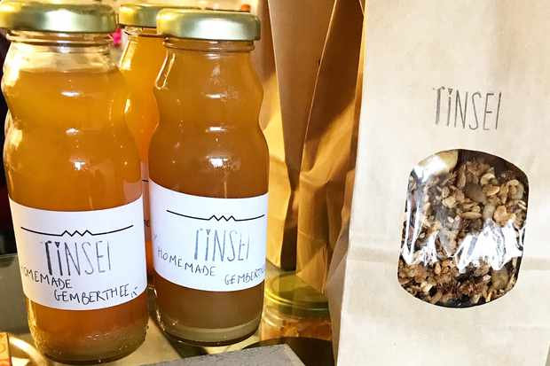Bottles of juice and brown bag of granola
