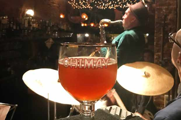 Goblet of beer infront of a drummer in a jazz club