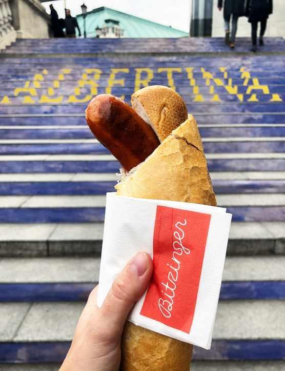 A hotdog infront of blue steps in Vienna