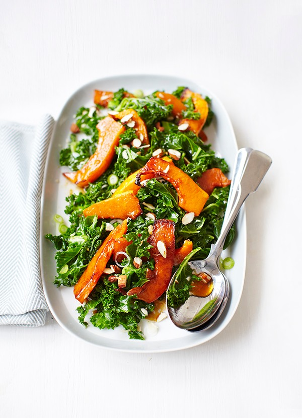 Kale salad with roasted butternut squash, pomegranate molasses and almonds