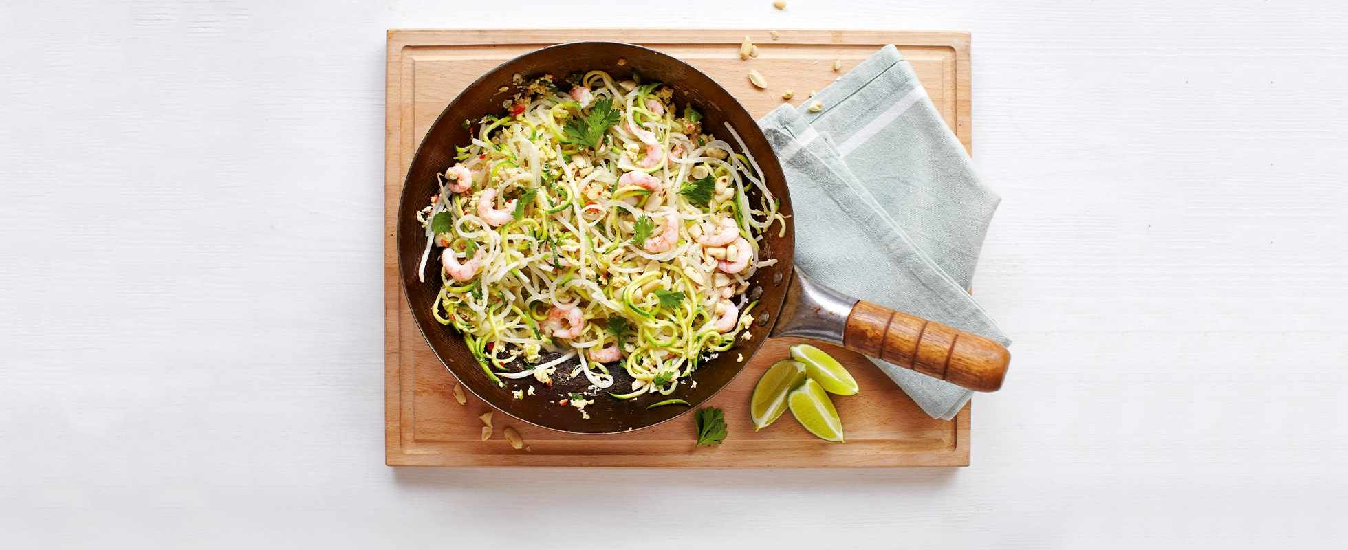 Frying pan full of healthy Pad Thai with prawns