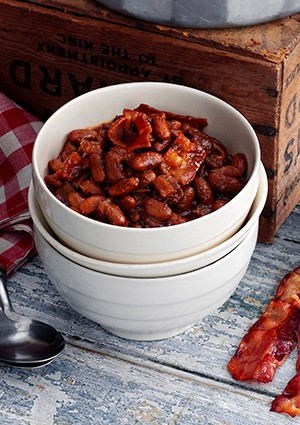 A white bowl filled with red baked beans