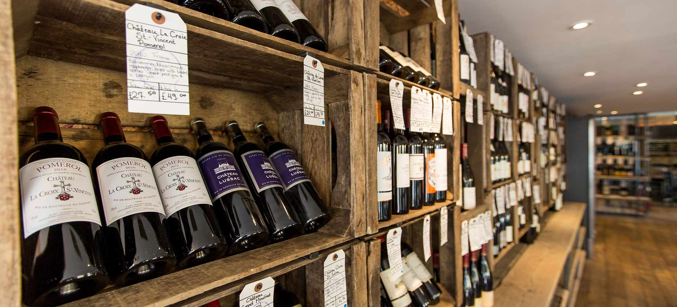 Wine bottles on wooden shelving