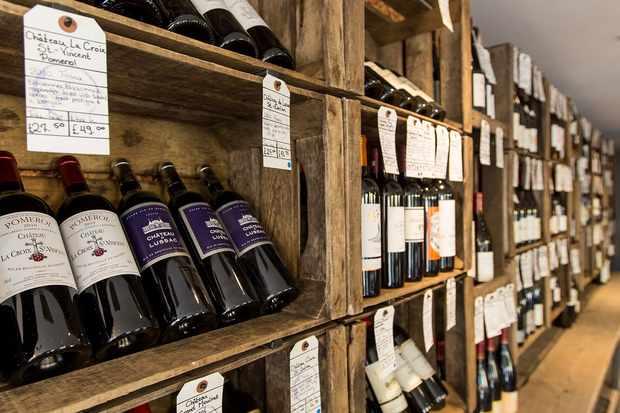 Wine bottles on wooden shelving