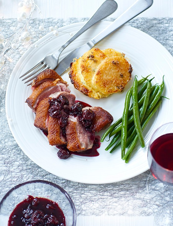Duck with sour cherry sauce and mini gratins