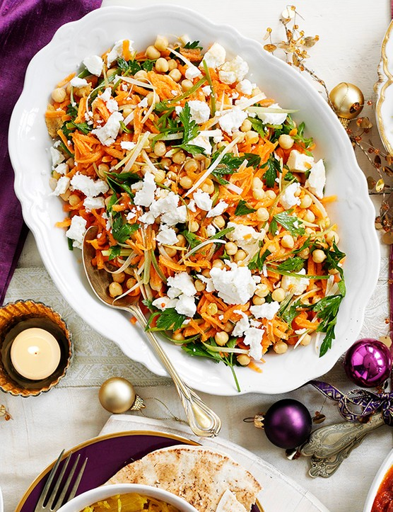 Carrot Salad Recipe with Chickpeas served on an oval white serving plate