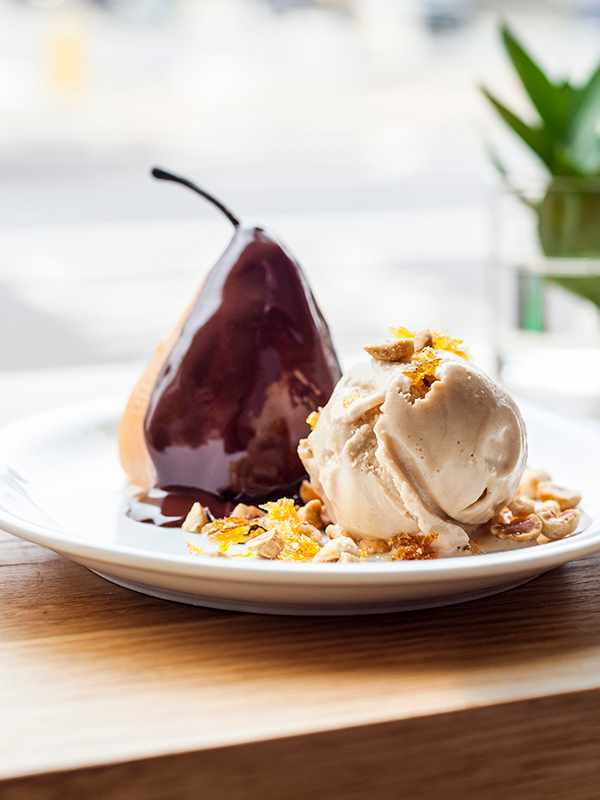 Crémant Poached Pear Recipe With Hazelnut Praline and Hot Chocolate Sauce